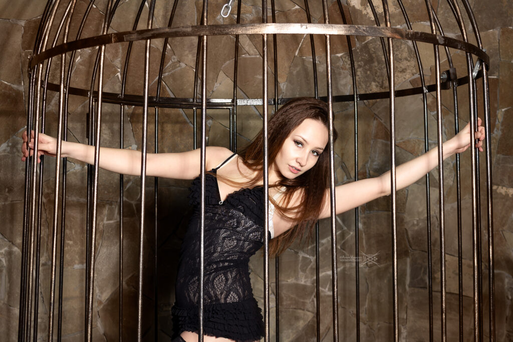 Girl in a cage